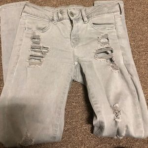American eagle low rise grey ripped skinny jeans